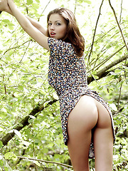 Tall model with short brunette hair goes out to nature with boots to kick ass and take names.